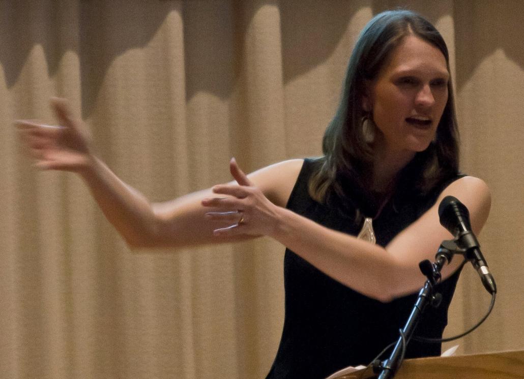 Janne Flisrand delivering a speech